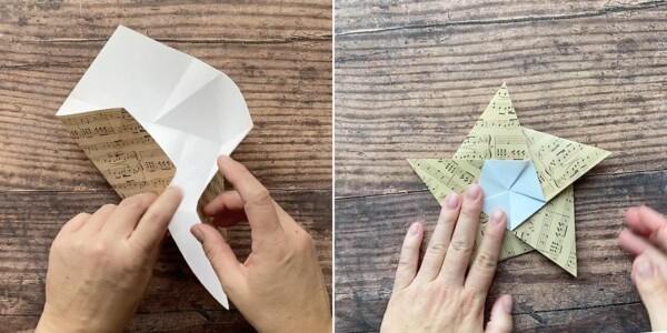 Hands folding pentagon into star