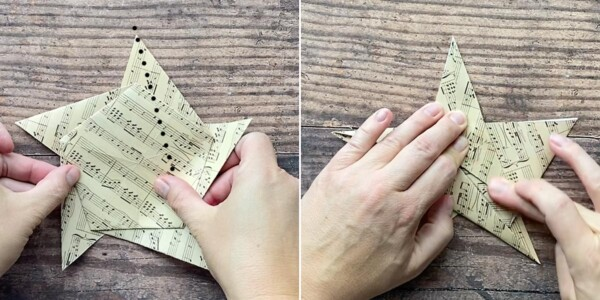 Hands creasing points of the star