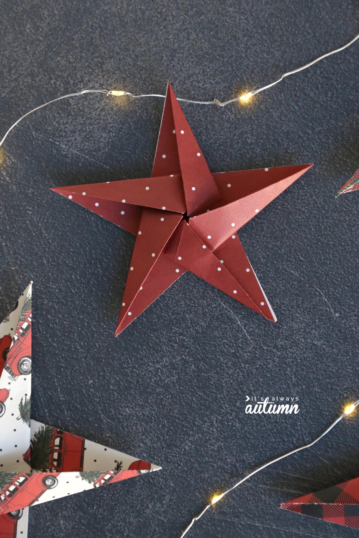 Red paper origami star on a garland