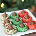 Plate of red and green Christmas cookies with Hershey kisses on top