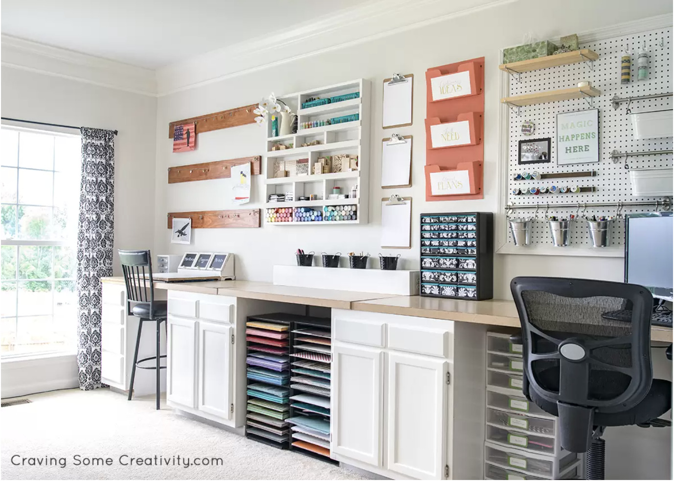 Large craft desk made with stock cabinets and plywood on top