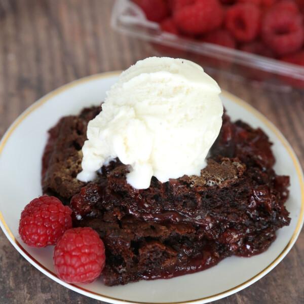 Chocolate raspberry cobbler with raspberries and vanilla ice cream