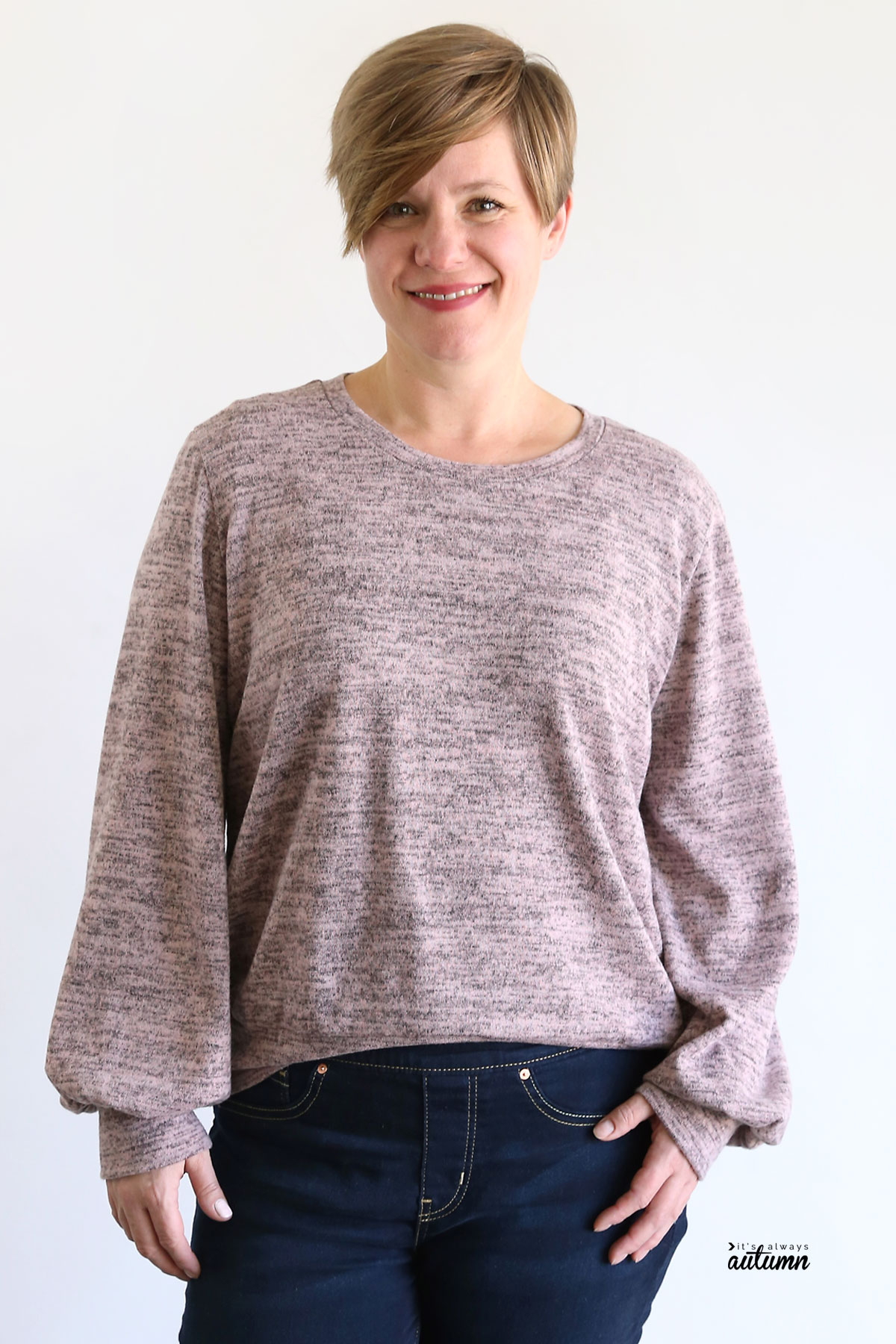 Woman wearing pink lantern sleeve sweater