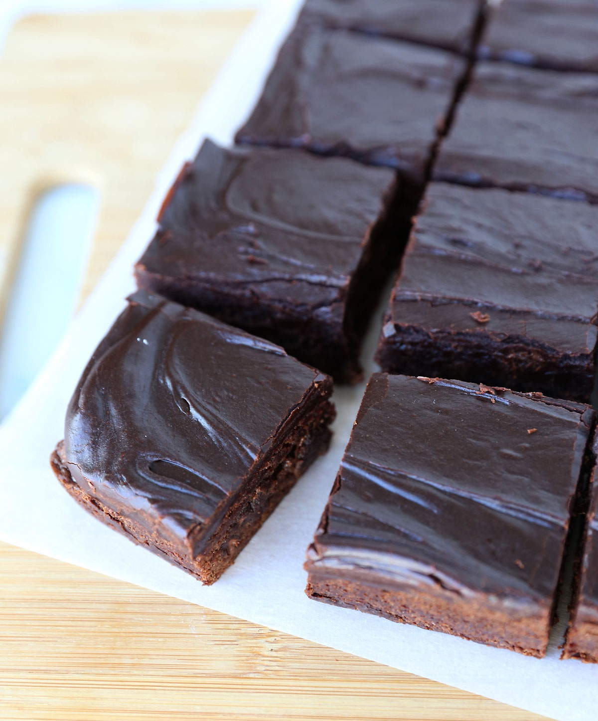 Frosted brownies on a cutting board