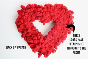 Back of heart wreath covered in loop yarn; on the right side all the loops have been pushed to the front