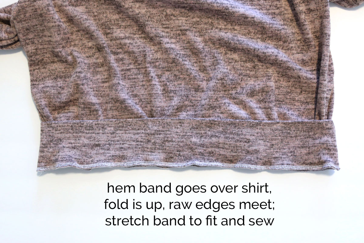 Hem band placed over bottom of shirt and sewn on