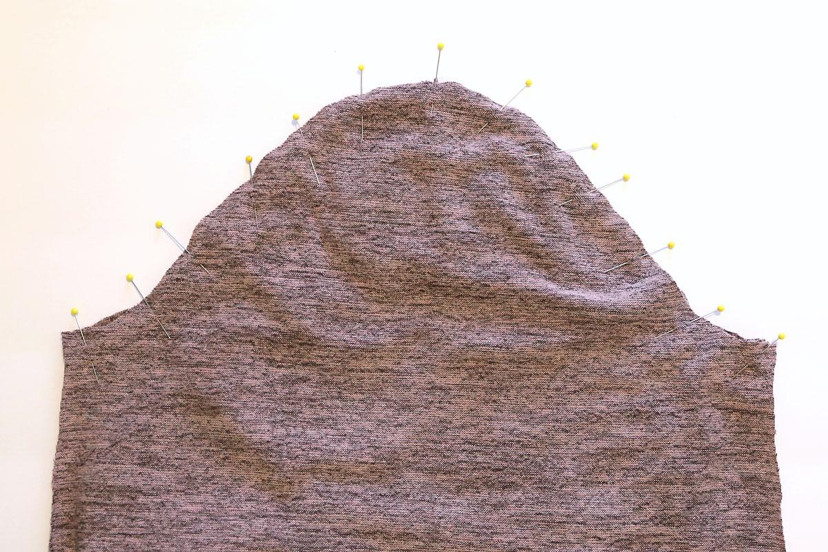 Sleeve piece pinned into armscye of shirt piece