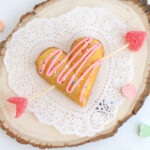 Twinkie heart with arrow through it and frosting and sprinkles on top