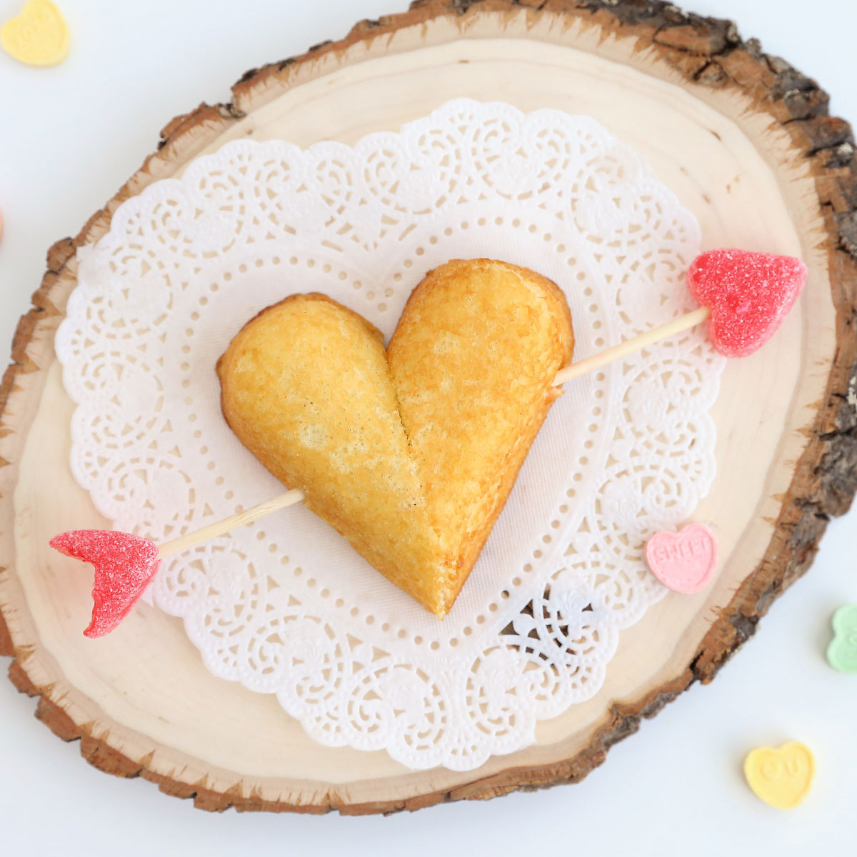 Twinkies cut to form heart shape with arrow through it made from skewer and jelly hearts