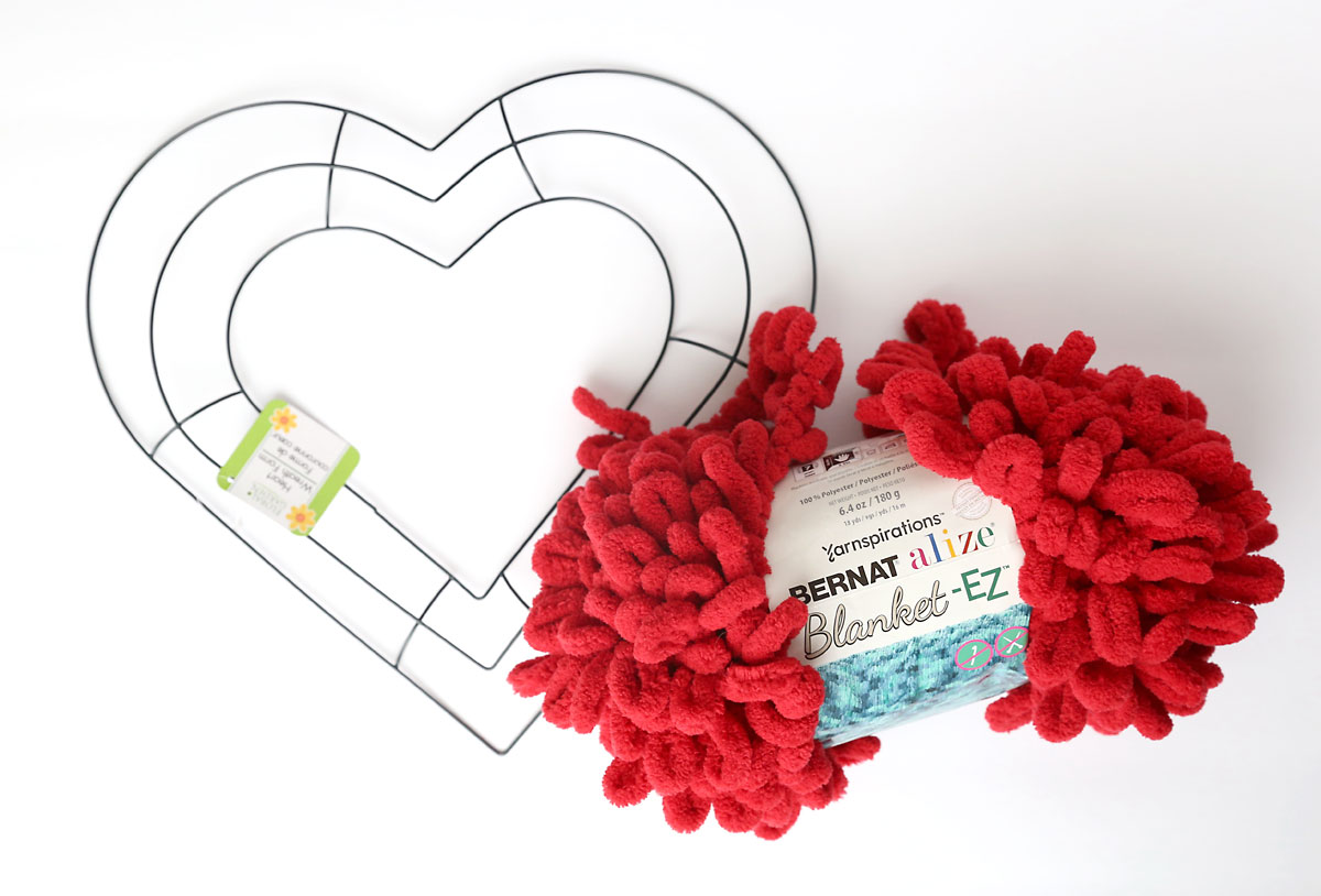 Dollar store wire heart shaped wreath form and red loop yarn