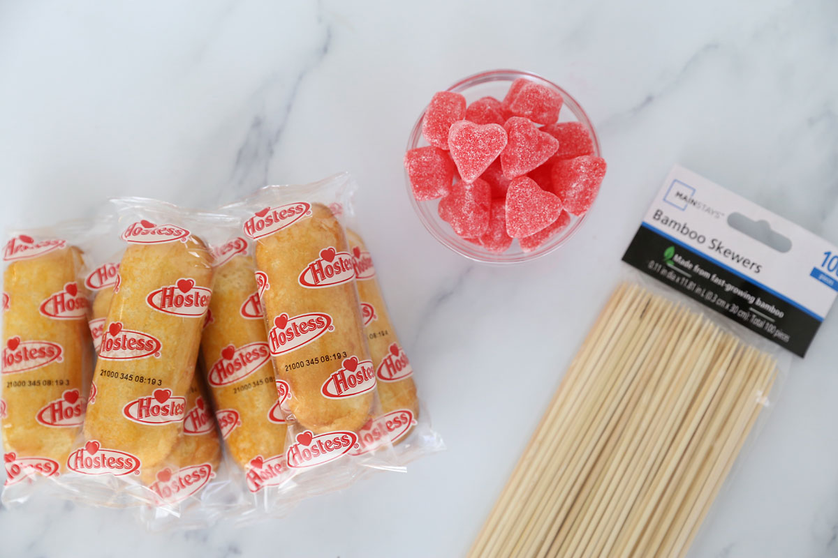 Supplies: Twinkies, red jelly hearts, wood skewers