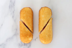 Two twinkies, cut diagonally from just below the curve on the outside to just above the curve on the inside