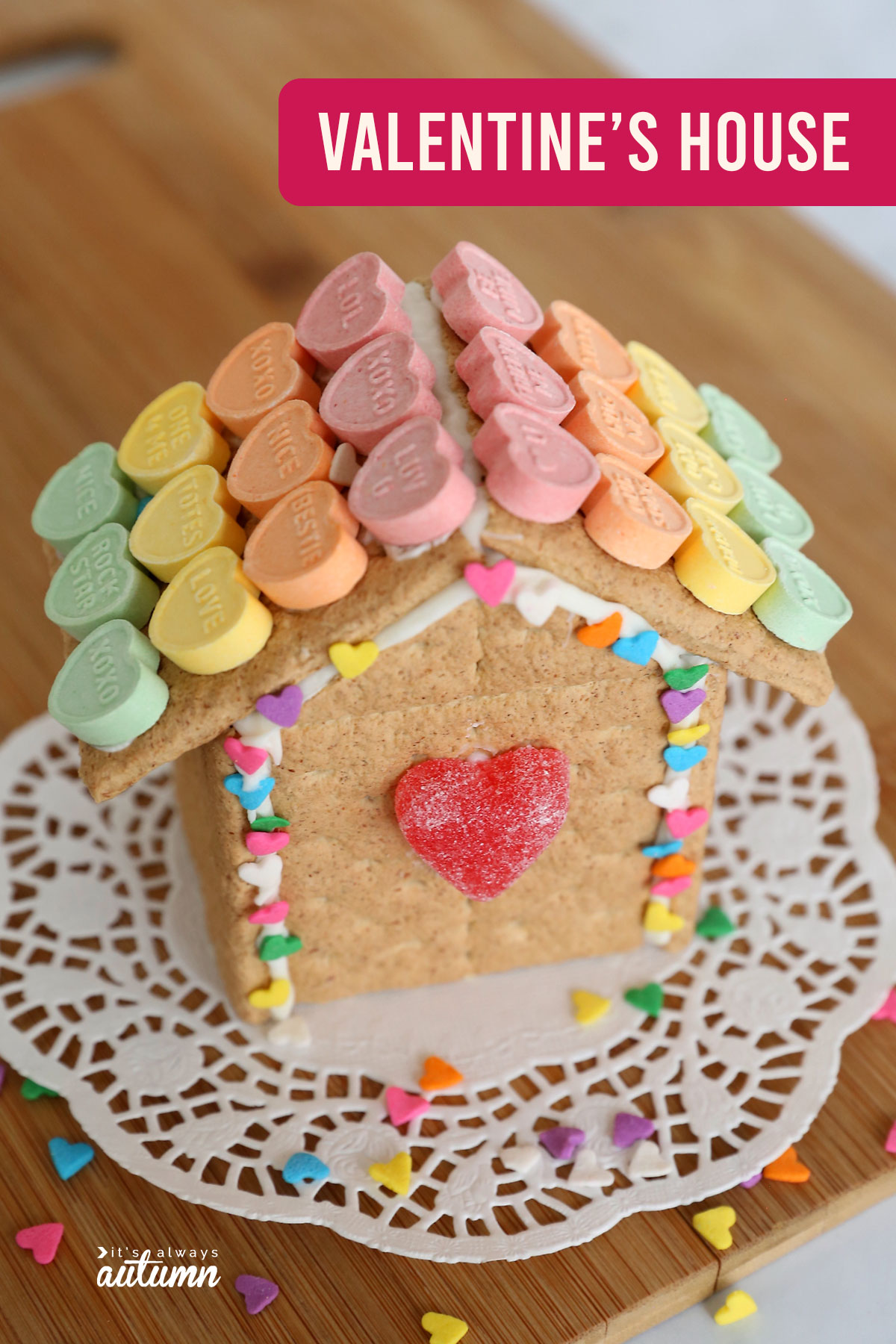 Valentine's Day gingerbread house made from graham crackers decorated with candy hearts