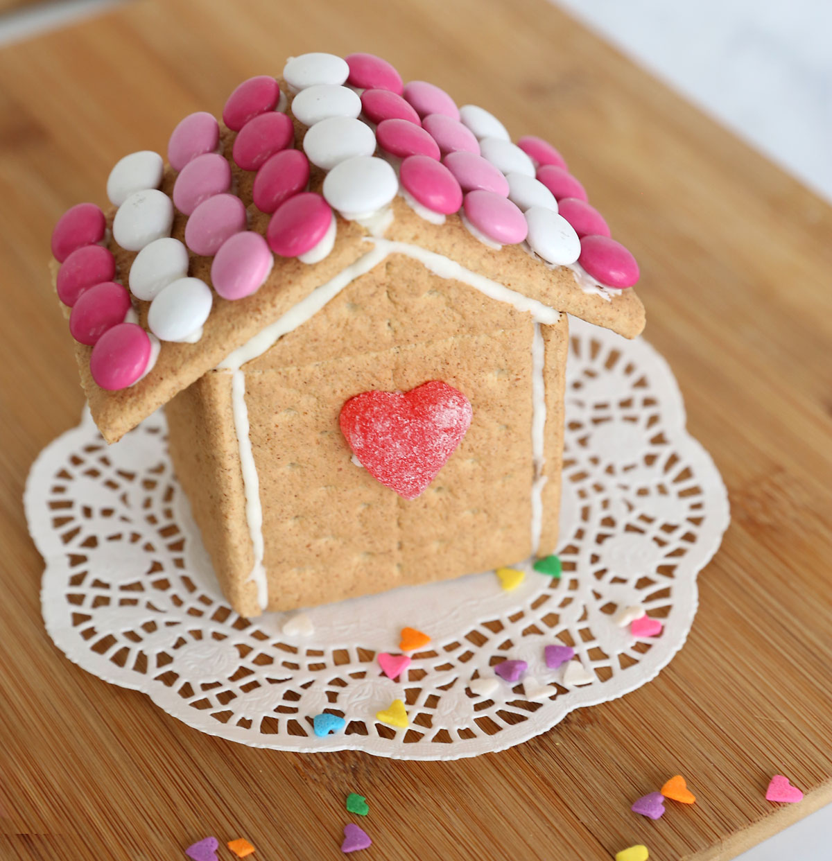 Valentine's house made from graham crackers decorated with M&Ms and candy hearts