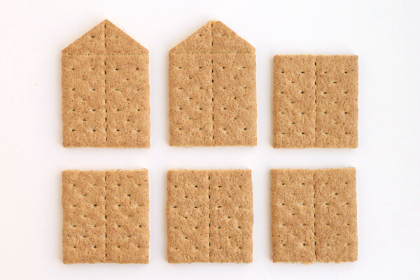 Graham cracker pieces needed to assemble house: four graham cracker halves and two graham cracker wall with roof support triangles