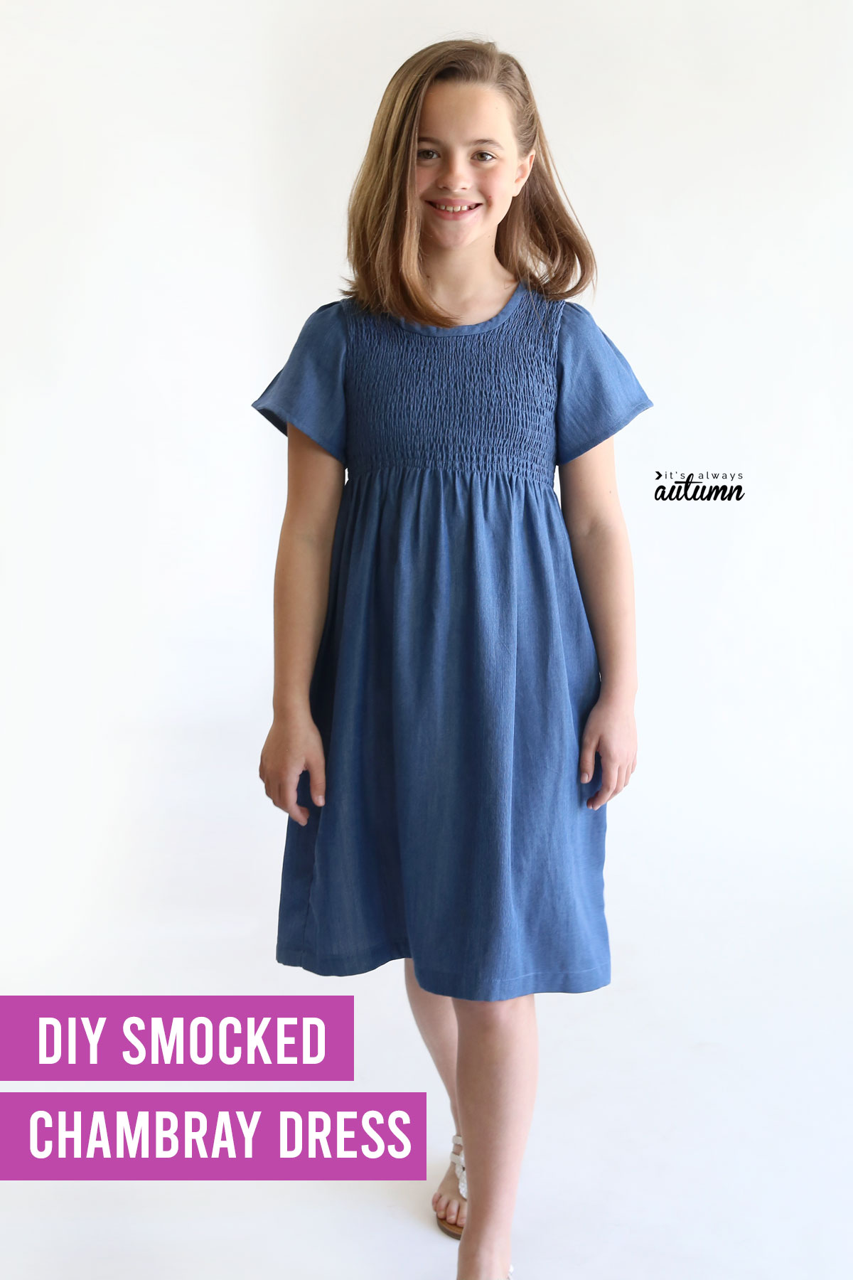 Wearing wearing a chambray dress with short sleeves, gathered top, and full skirt; DIY smocked chambray dress