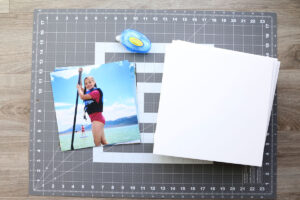 Photos, foam core squares, adhesive, and large cutting mat