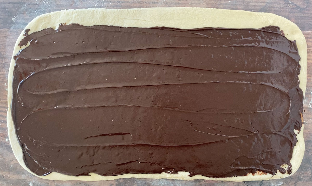 Rectangle of bread dough spread with chocolate babka filling