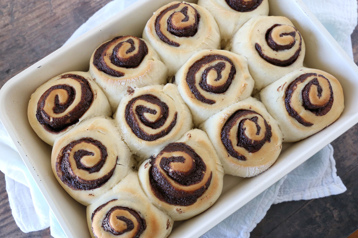 Baked chocolate babka rolls in a 9x13 pan, golden brown