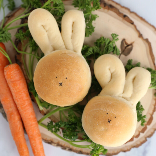 Dinner rolls in the shape of a bunny with carrots and herbs