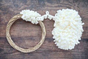 Wreath form with loop yarn wrapped around it