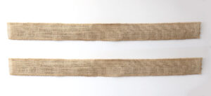 Two strips of burlap ribbon glued together with pipe cleaners in between them