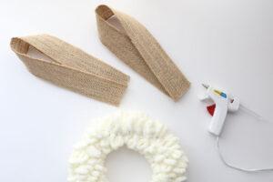 Top of wreath; burlap ribbon folded over to look like bunny ears; hot glue gun