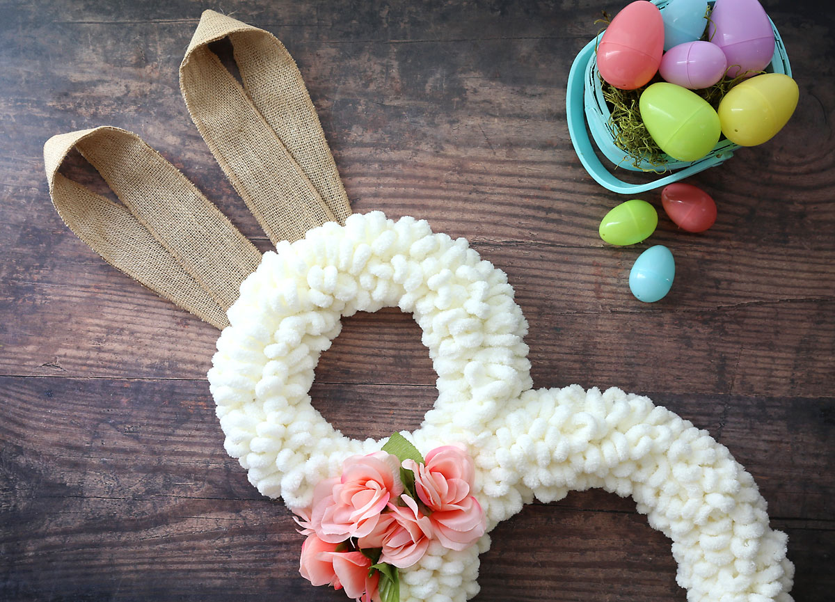 Easter bunny wreath made from cream loop yarn with burlap ribbon ears