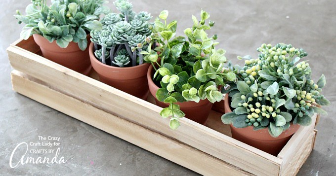 Wood shim planter box with potted plants inside