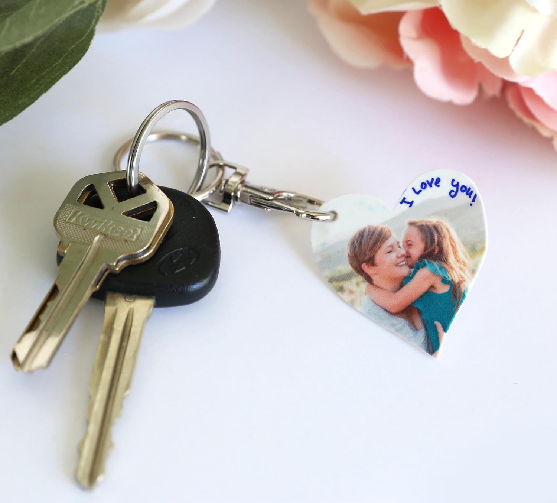 Keys on a keychain with a DIY heart shaped photo keychain