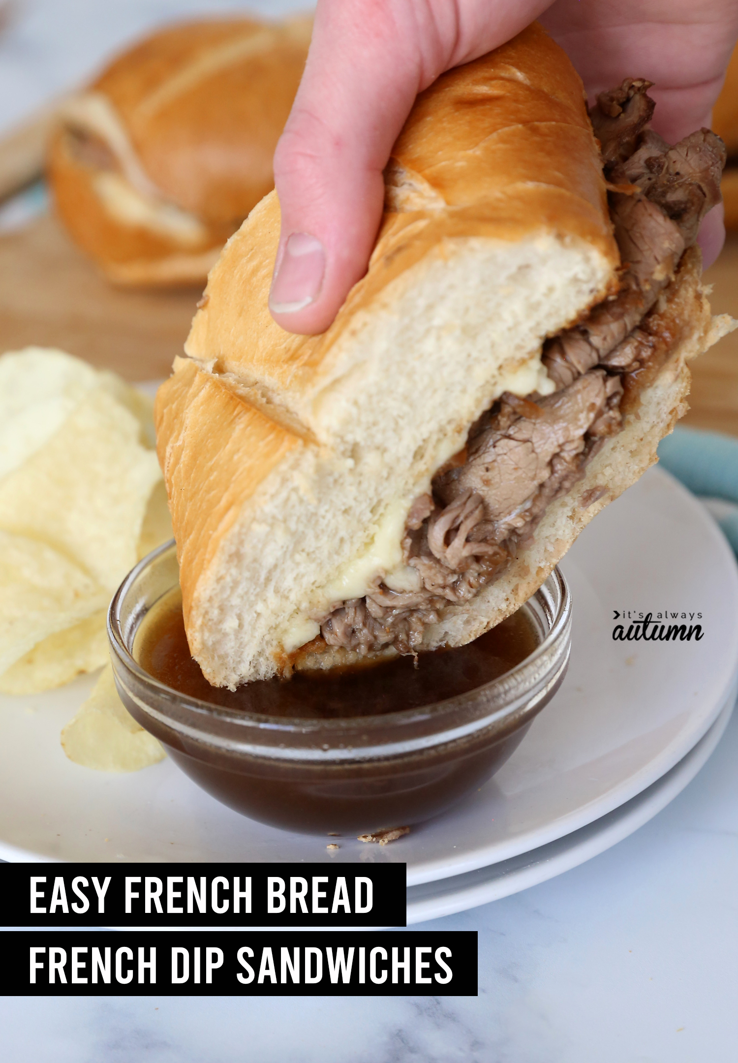 Hand dipping roast beef sandwich into au jus with words: easy french bread french dip sandwiches