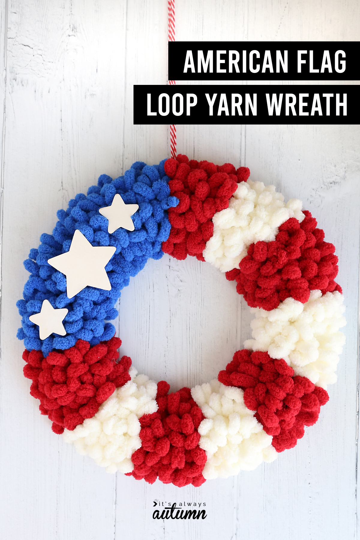 Wreath wrapped with blue, red, and white loop yarn to look like an American flag with words: American flag loop yarn wreath