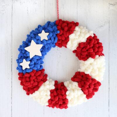 American flag loop yarn wreath hanging on a wall