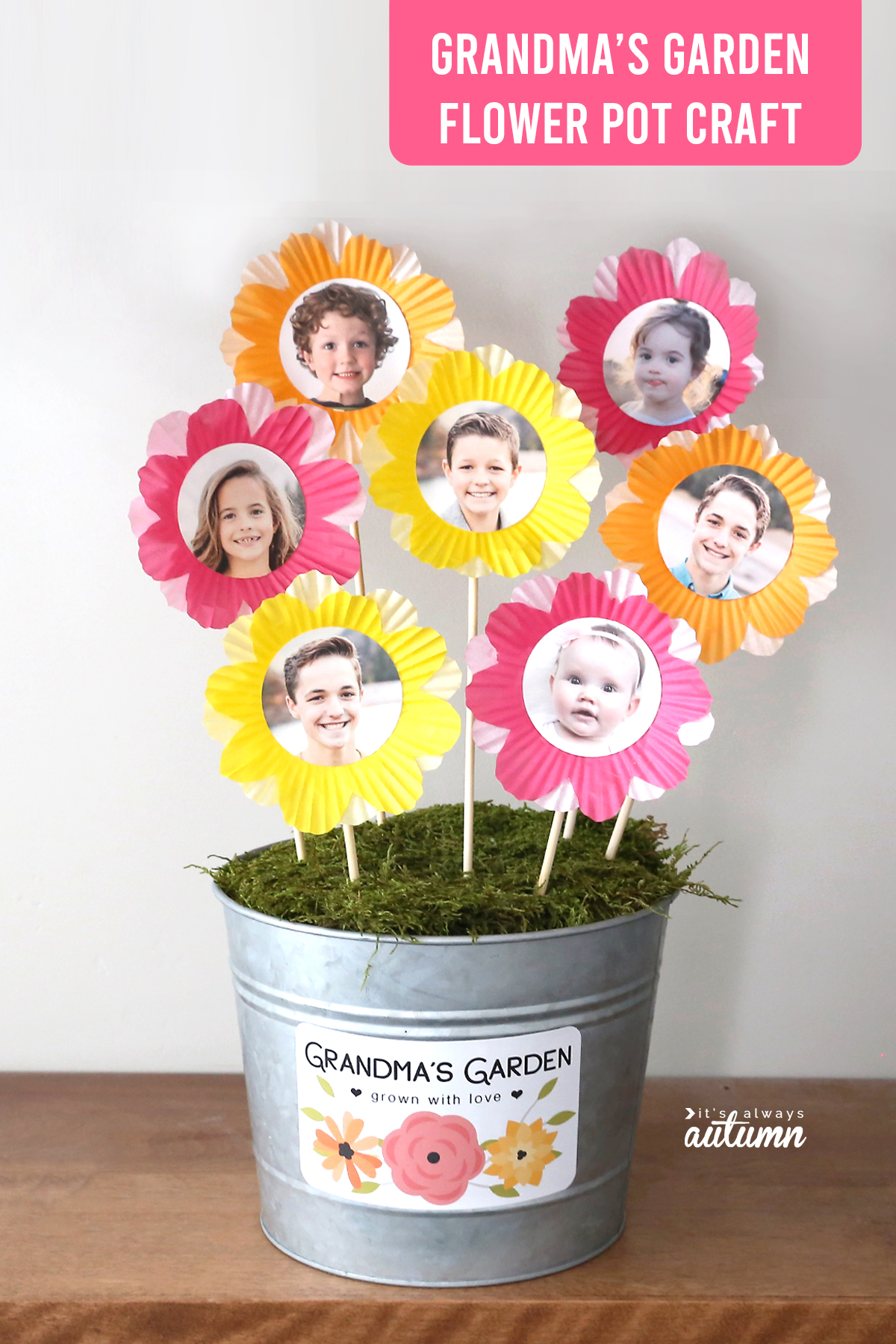 Flower pot with label: Grandma's garden, grown with love; with flowers made from photos and cupcake liners