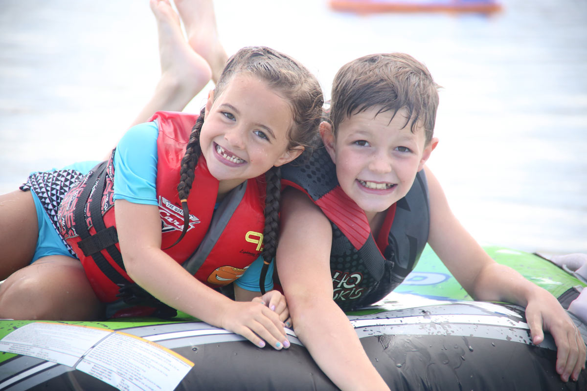 Boy and girl wearing life jackets