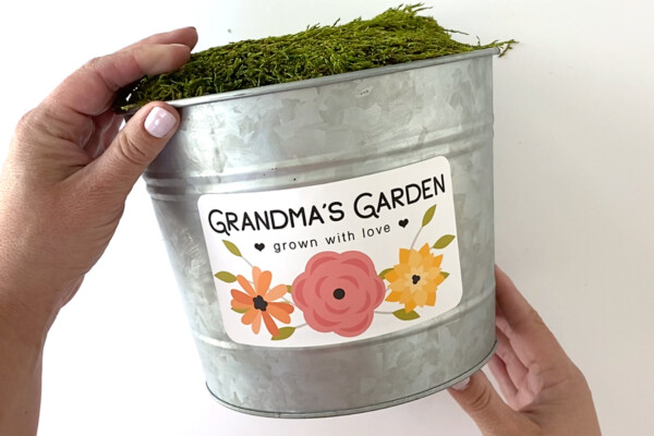Metal flower pot with label that says Grandma's Garden, grown with love