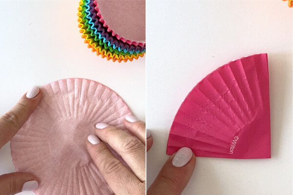 Hands folding colored cupcake liners into quarters