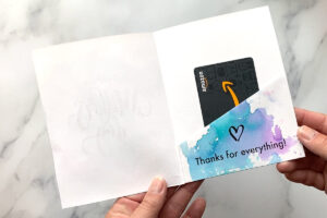 Flap has been folded up inside the card to create a pocket for a gift card