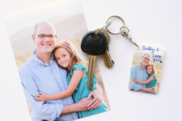Photo of a girl and her dad; same photo on a DIY keychain
