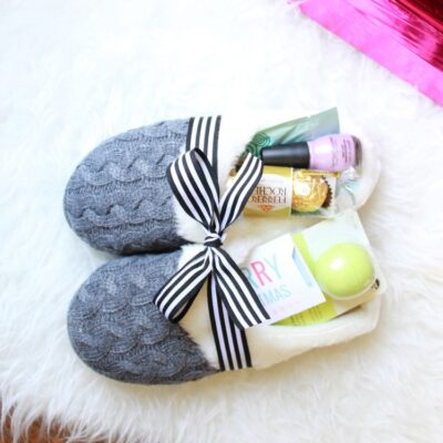 Slippers tie with a bow stuffed with gifts
