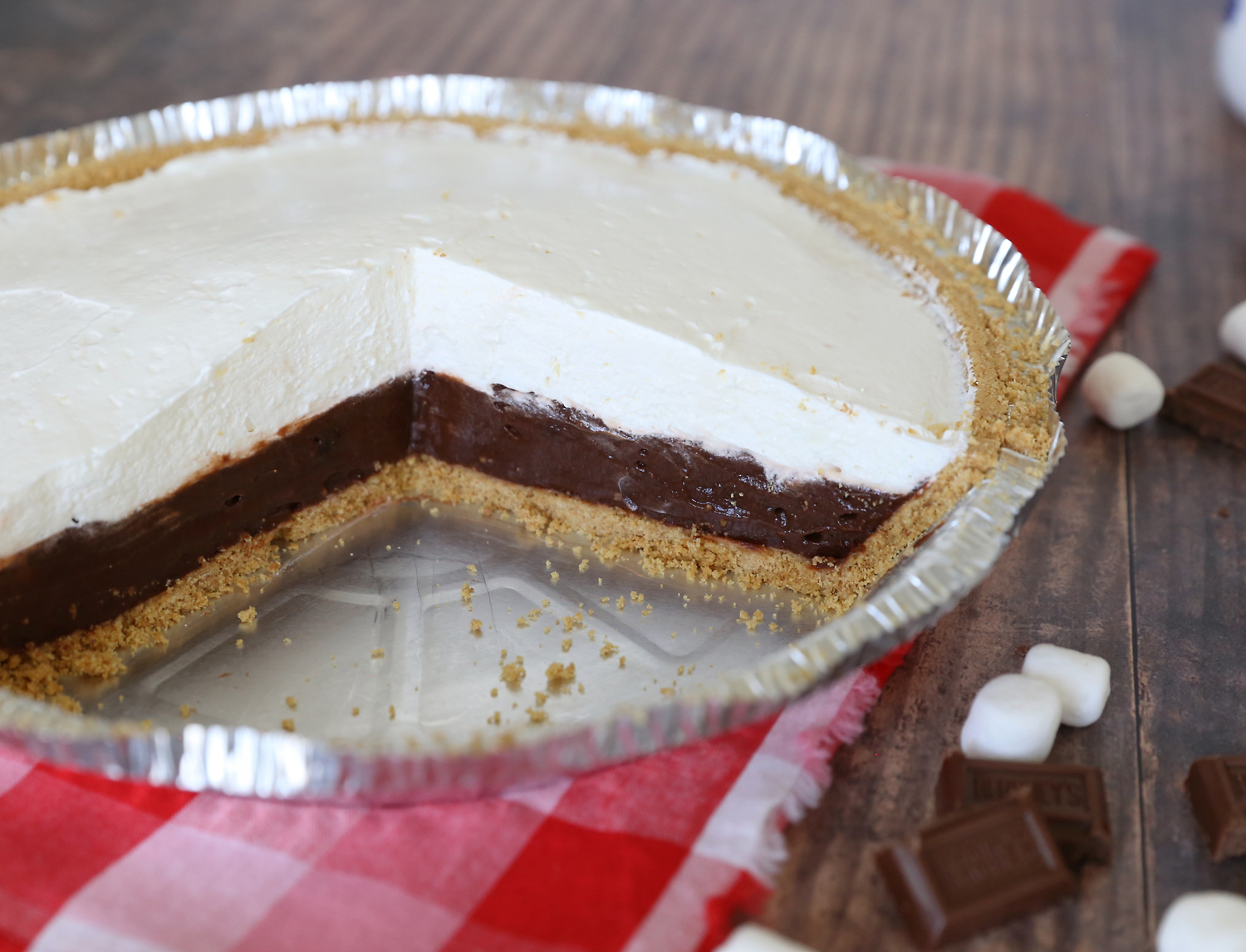 S'mores pie in a pie plate with a few pieces gone