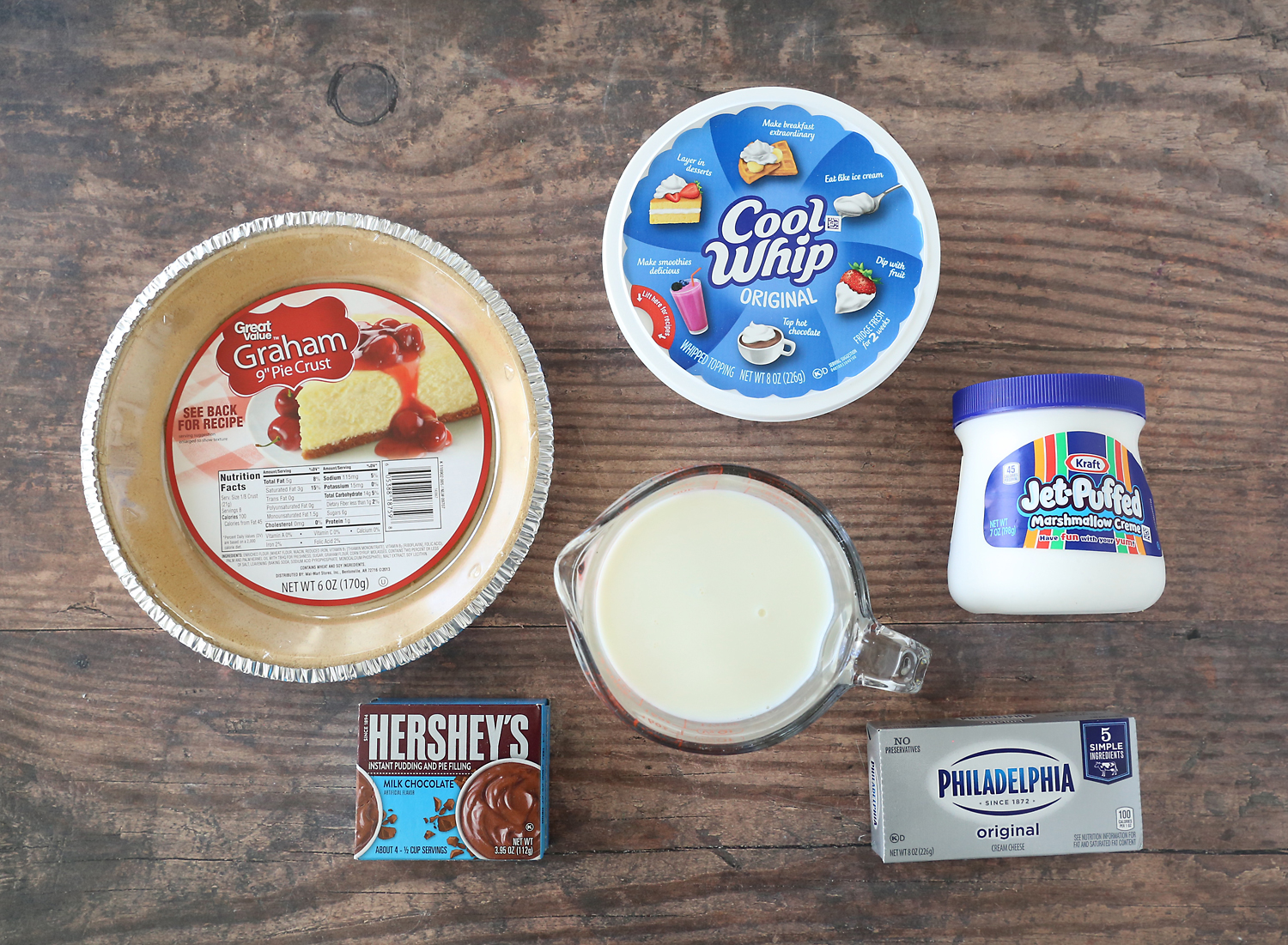 Ingredients: graham cracker pie crust, chocolate pudding, milk, cream cheese, marshmallow fluff, whipped topping