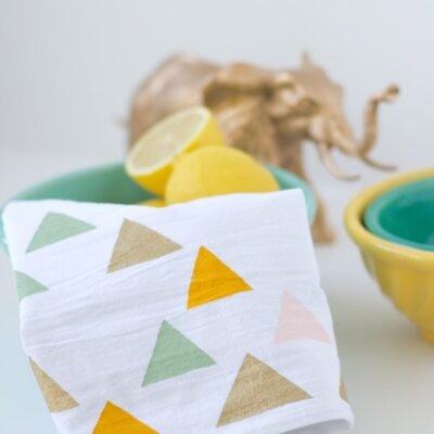 Geometric painted tea towel in a bowl with lemons