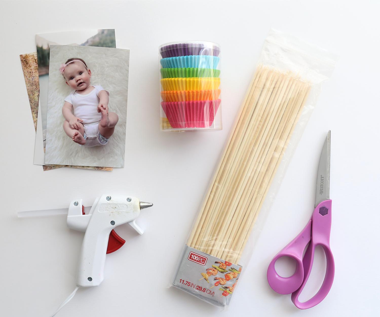 Supplies: photos, colored cupcake liners, wood skewers, scissors, hot glue gun