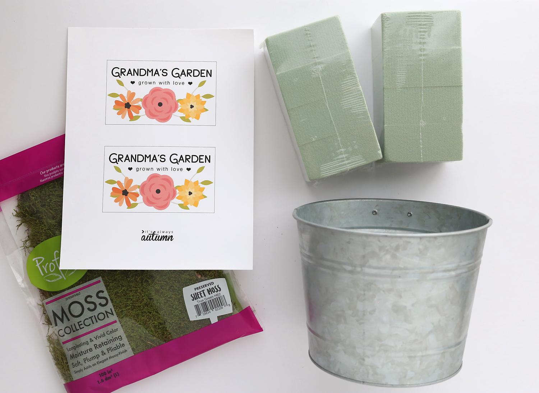 Supplies: metal flower pot, floral foam, label ons sticker paper, foam
