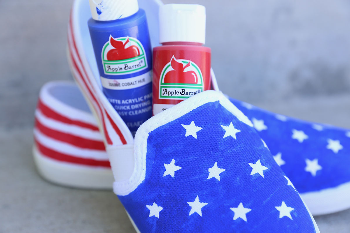 Pair of DIY flag shoes with red and blue acrylic paint