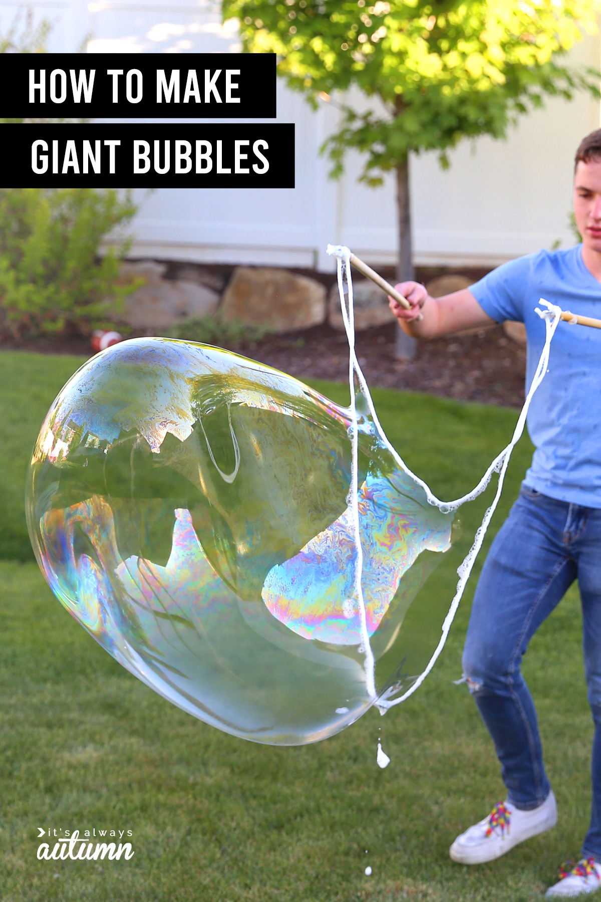 Boy blowing giant bubble with word: How to make giant bubbles