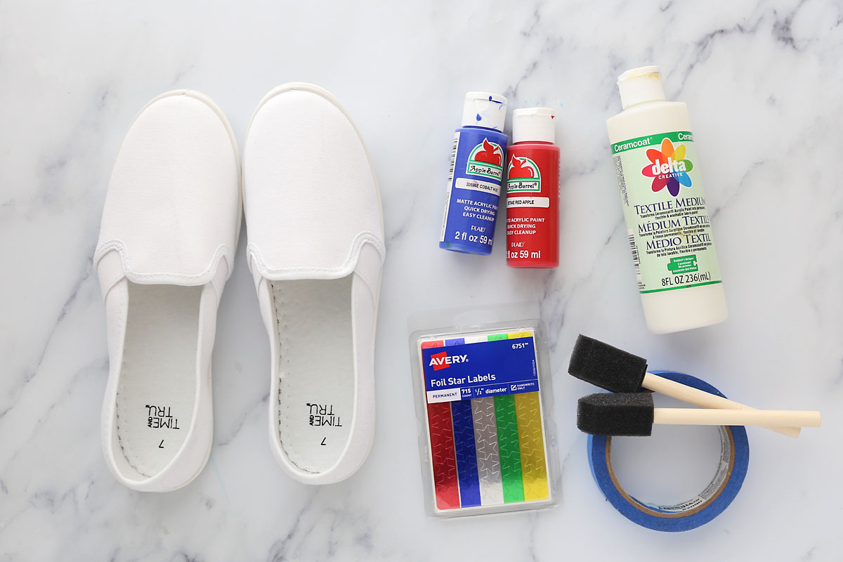 supplies: canvas shoes, star stickers, acrylic paint, fabric medium, foam brushes, tape