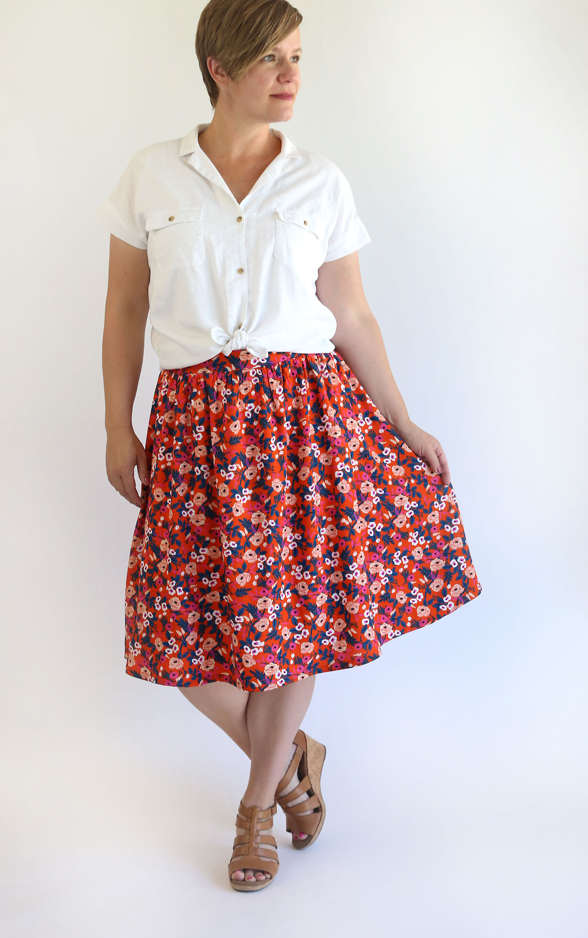 woman wearing red floral gathered skirt
