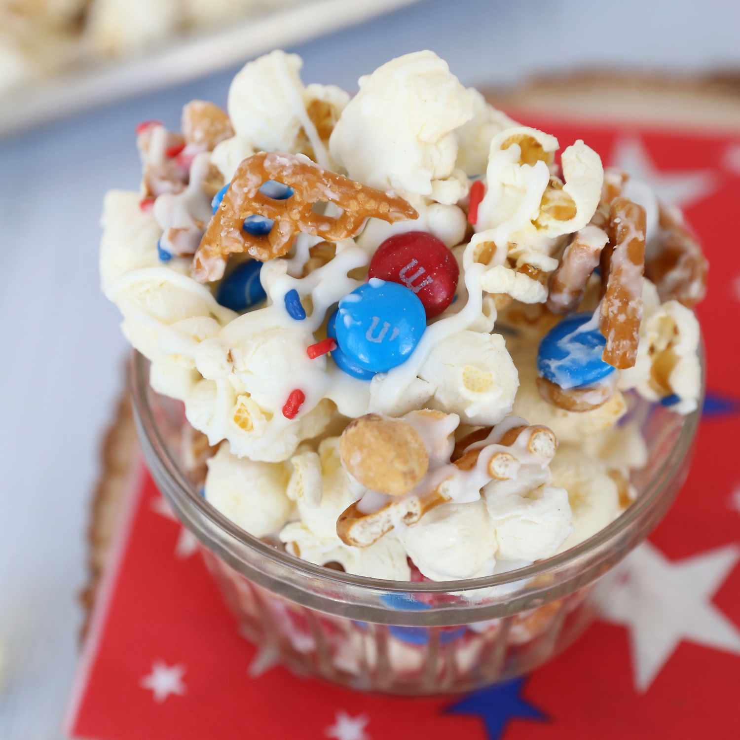 Bowl of patriotic popcorn mix with pretzels and M&Ms
